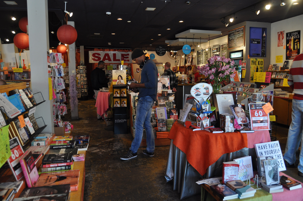 A customer browses the diverse book selection at Outwrite on the iconic bookstore's final day at its Midtown location.