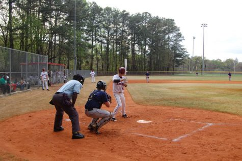 Luke Leonard settles into the batters box waiting for his pitch to hit.