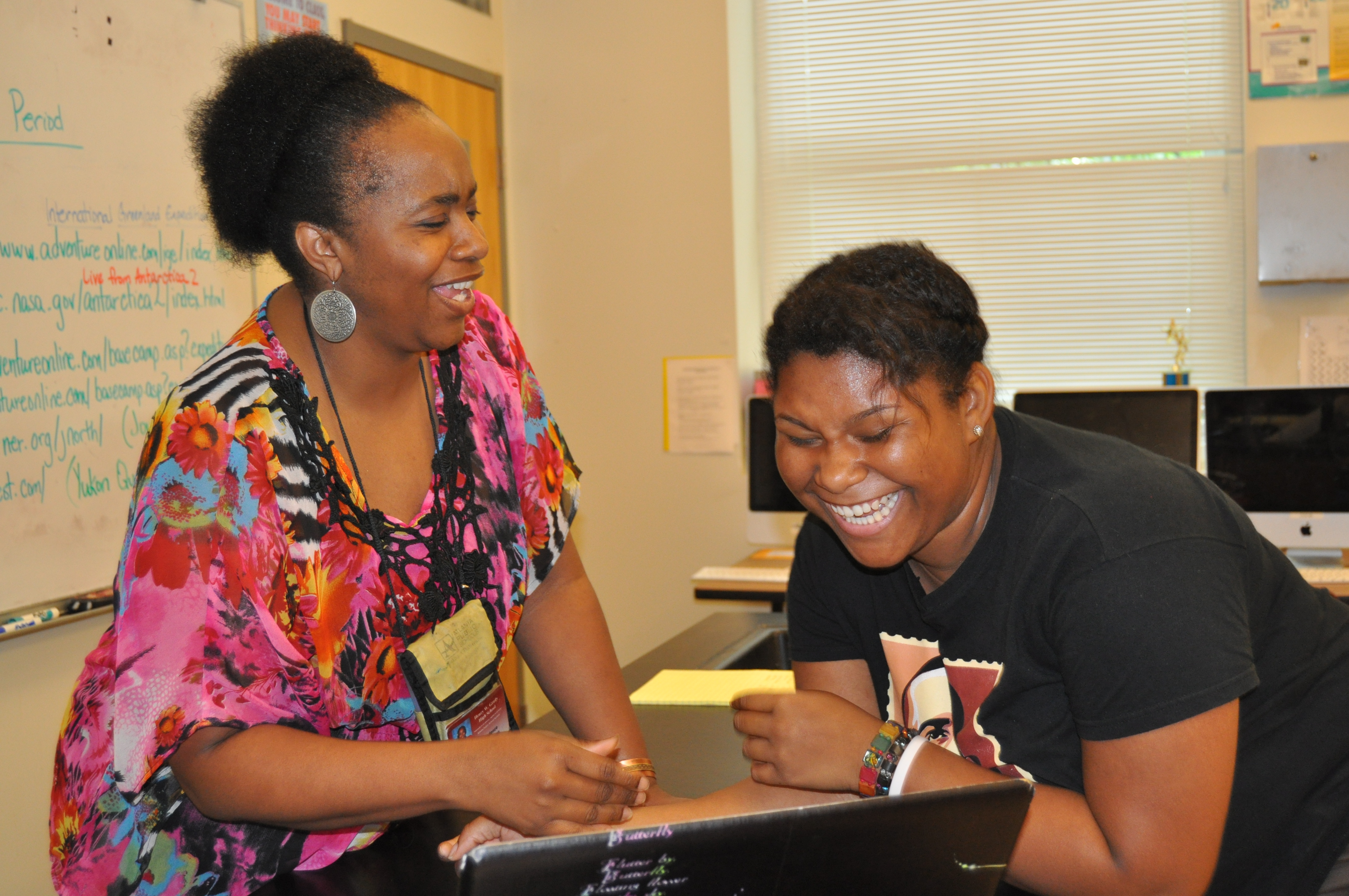 Dr. Cadence Spearman, Grady's 2012 Teacher of the Year, is pictured with a student. The AP and Honors Biology teacher discovered she'd earned the accolade after receiving a text message from a faculty member.