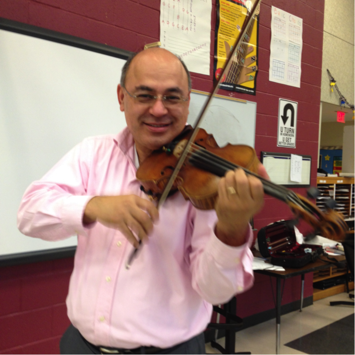 Grady's orchestra teacher, Sergio Rodriguez, says music helped him  thrive in a difficult neighborhood in Honduras.