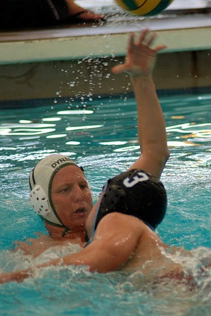 Along+with+fellow+APS+Knights+coaches+Robin+Smith+and+Monica+Szalma%2C+Coach+Stu+also+plays+for+Dynamo+Water+Polo+Club.++During+a+Dynamo+WPC+game%2C+Stu+%28dark+cap%2C+with+ball%29+reads+the+defense+as+he+decides+to+set+the+ball+to+his+teammate+in+front+of+the+white+team+goal%2C+pass+away+to+a+distant+teammate%2C+or+shoot.