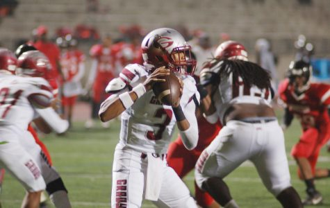 Junior quarterback Caylin Newton looks for a receiver in the Nov. 5 game against Stone Mountain.