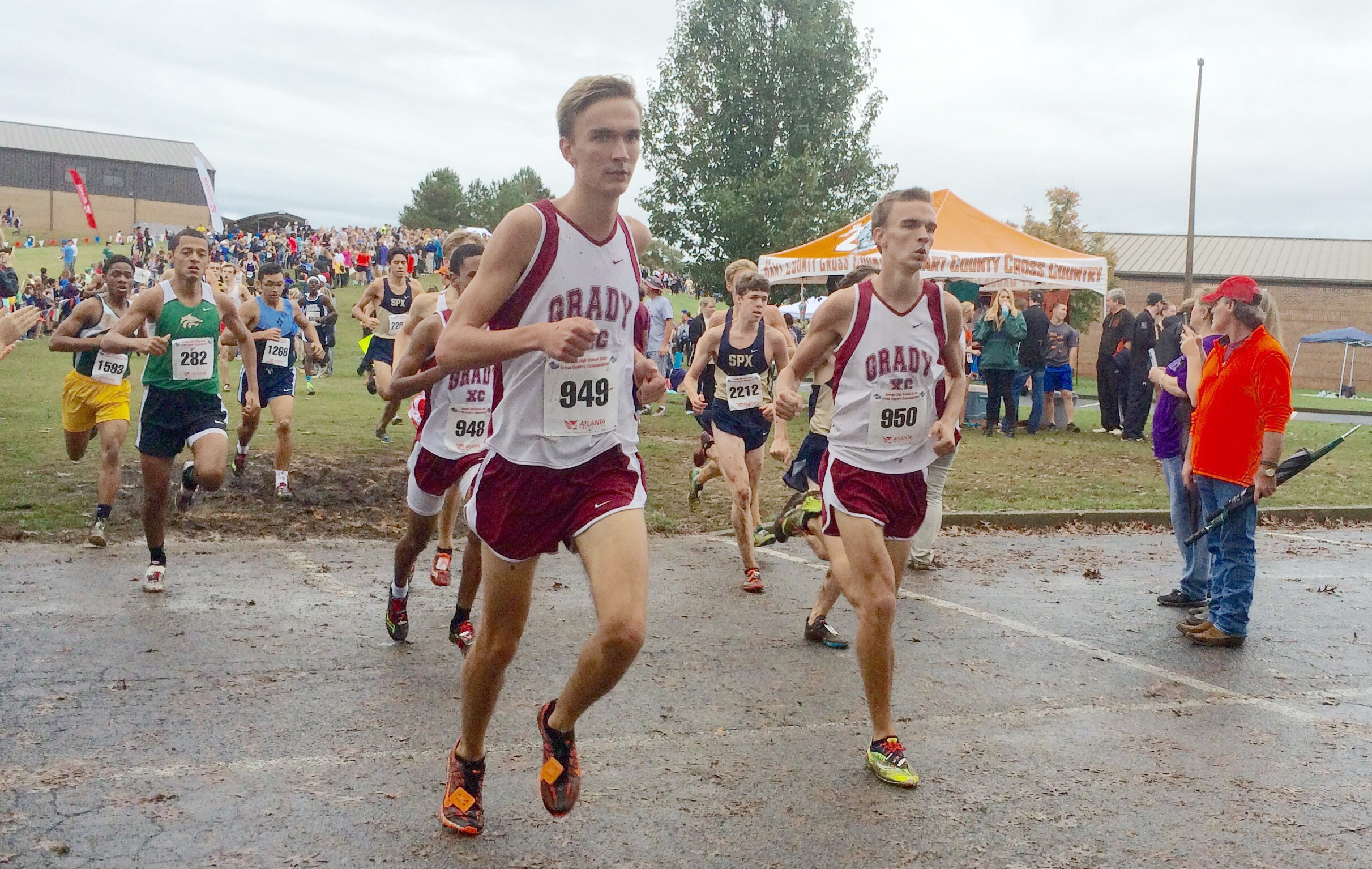 Graham (right) and Anders Russell (left) lead the boys toward the finish line during the state meet.