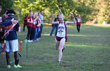 Senior Gracie Griffith takes first place at the 2015 APS Cross Country Championship on Oct. 14. During her high school career, she has participated in varsity cross country, soccer, and basketball. She has recently entered various longs distance running events, including 10ks and half marathons.
