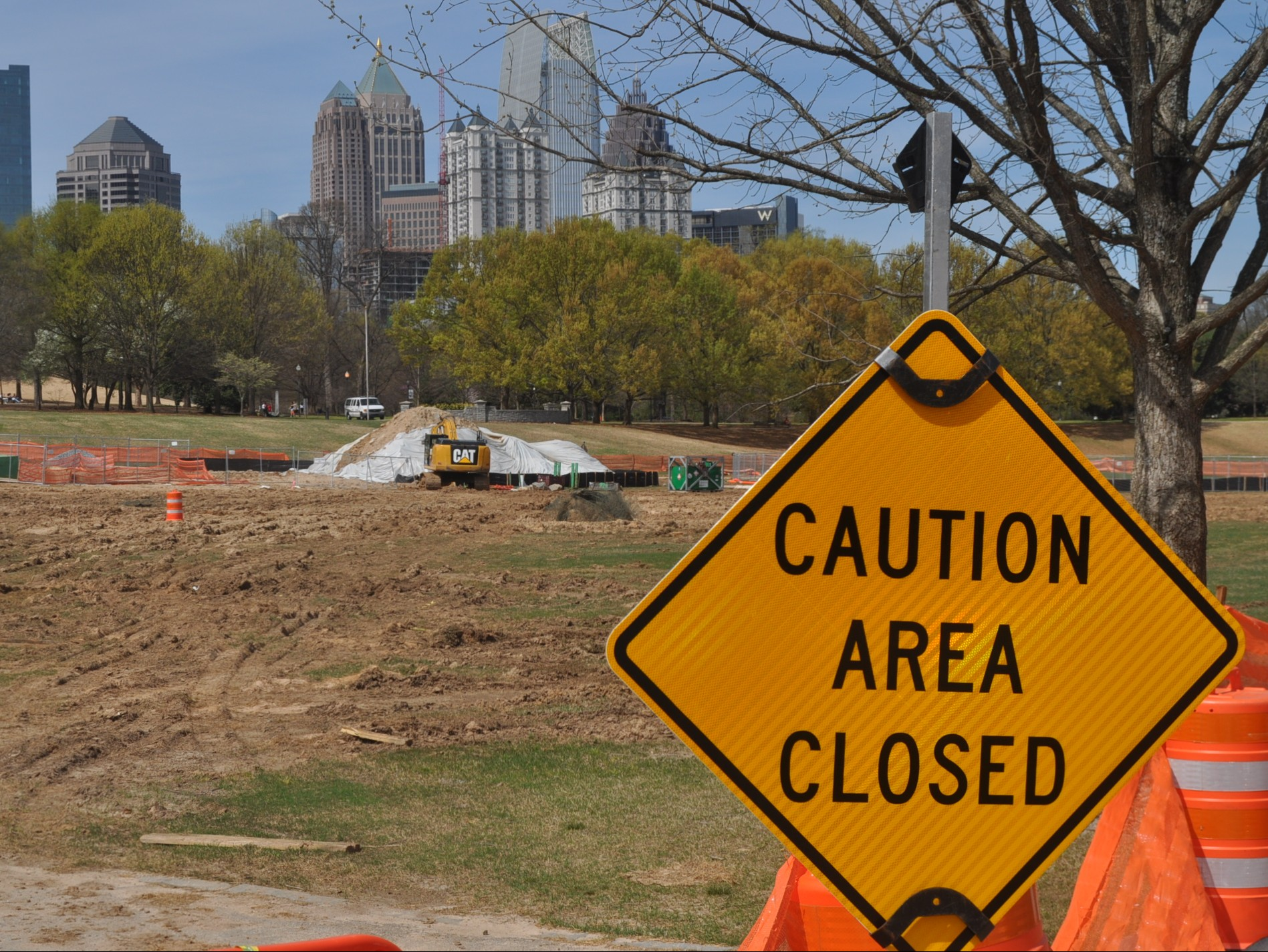 CAUTION: A construction crew digs up the meadow of Piedmont Park in March to fix a sinkhole that appeared in December.