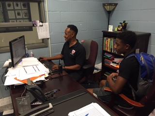 SCHEDULING GURU: Mr. Vincent helps senior Karlito Mays fix holes in his schedule