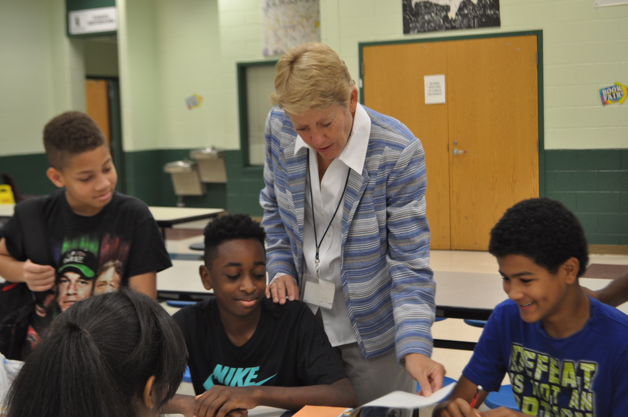 Dr. Betsy Bockman helps an Inman Middle School student with homework before school begins. Bockman plans to bring the same commitment to the school to her new job as interim principal of Grady, starting Sept 12.