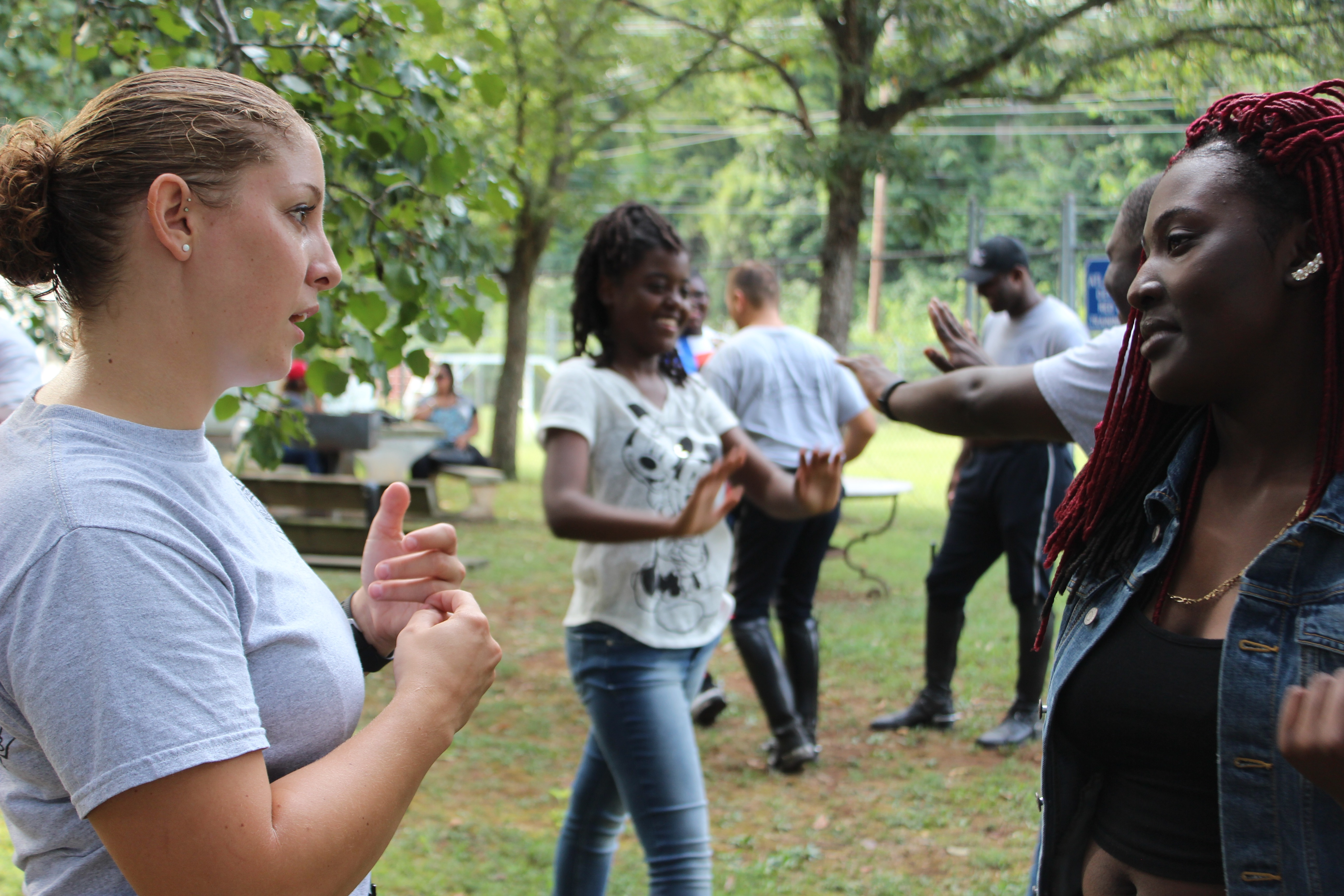 In a regular Atlanta Police Foundation meeting, Aug. 31, mounted police officers and their mentorees split into small groups to do trust falls. During this time, groups have time  to bond and catch up.