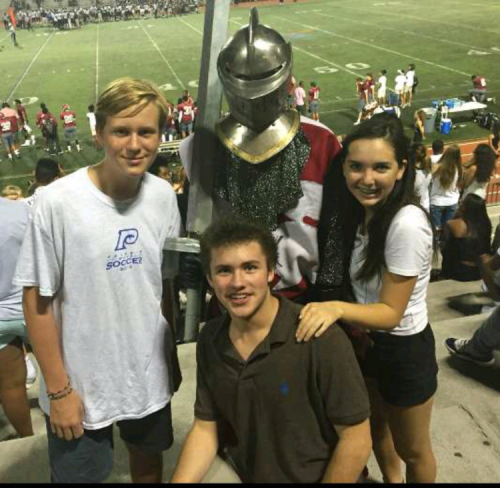 New Grady mascot Seth Cullen keeps spirits high at the Grey Knights' season-opening 53-0 victory over rival North Atlanta. Pictured from left to right: Ethan Thomas, Paideia freshman, David Coffman, Grady freshman and Liah Lawson, Grady freshman.
