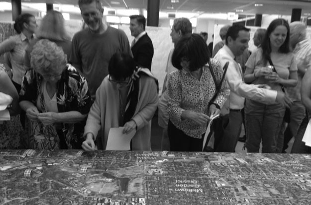 THE+ROAD+TO+CHANGE%3A+Community+members+gathered+in+Grady%27s+Cafeteria+to+hear+about+the+city%27s+improvements+to+Monroe-Boulevard.+The+plans+will+likely+include+a+bike+lane+to+make+the+area+safer+for+bikers.