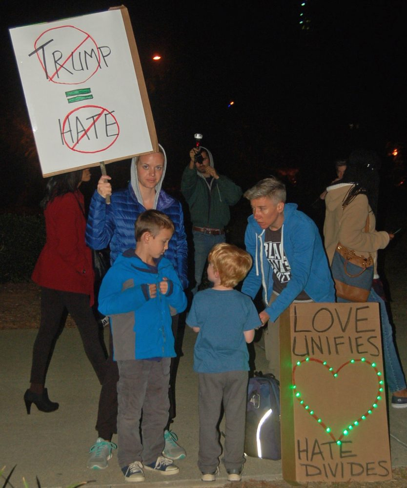 Atlanta residents, Kate Holoman and Ainsley Waking, stand with their son's at Friday's protest.