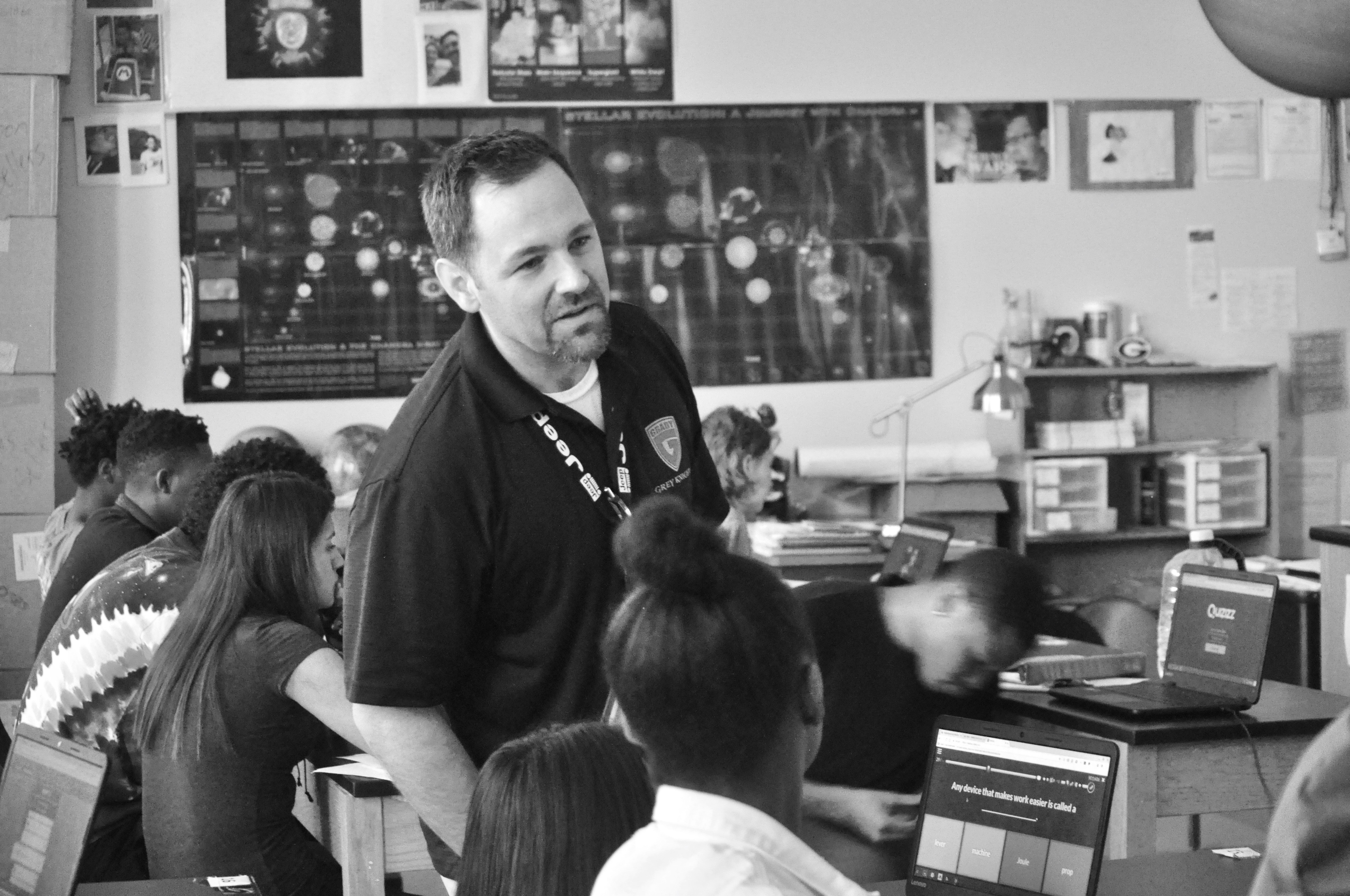 Current physical science teacher Ben Sellers reviews with his students. Sellers is responsible for designing the curriculum for Grady's new Energy and Power course, which focuses on vocational science applications.
