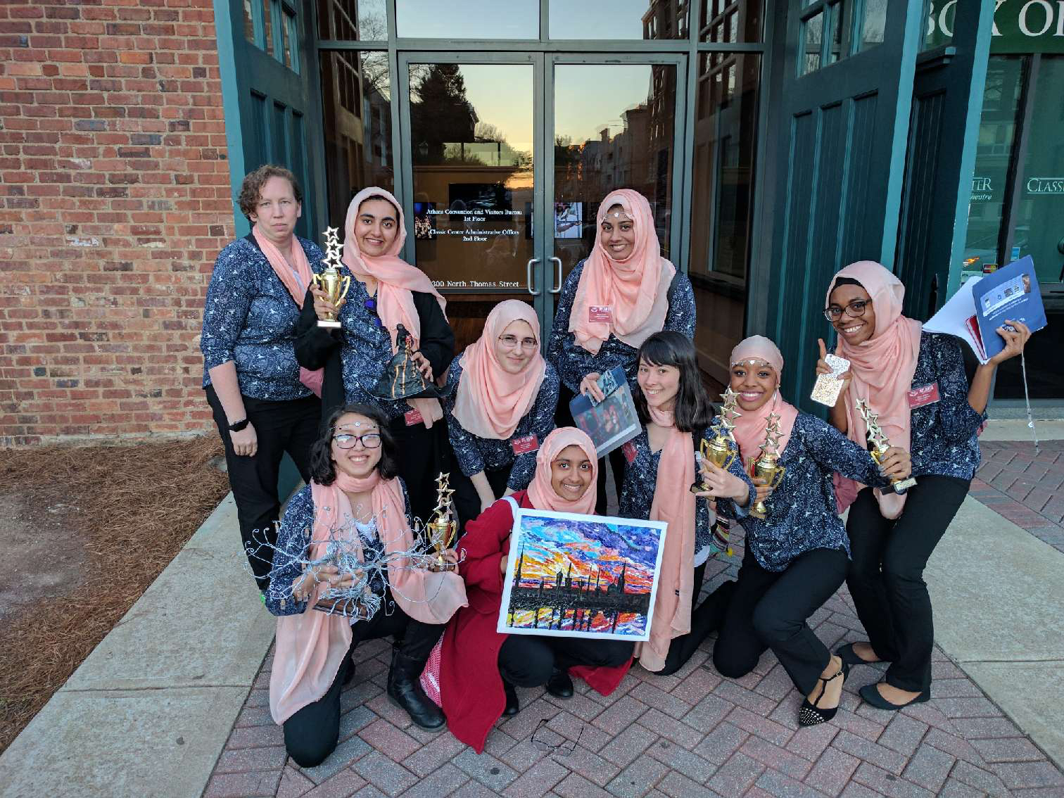 The Grady Muslim Students Association showcase their awards won during MIST, including second in photography, first and third in 3D art, and first place in spoken word.