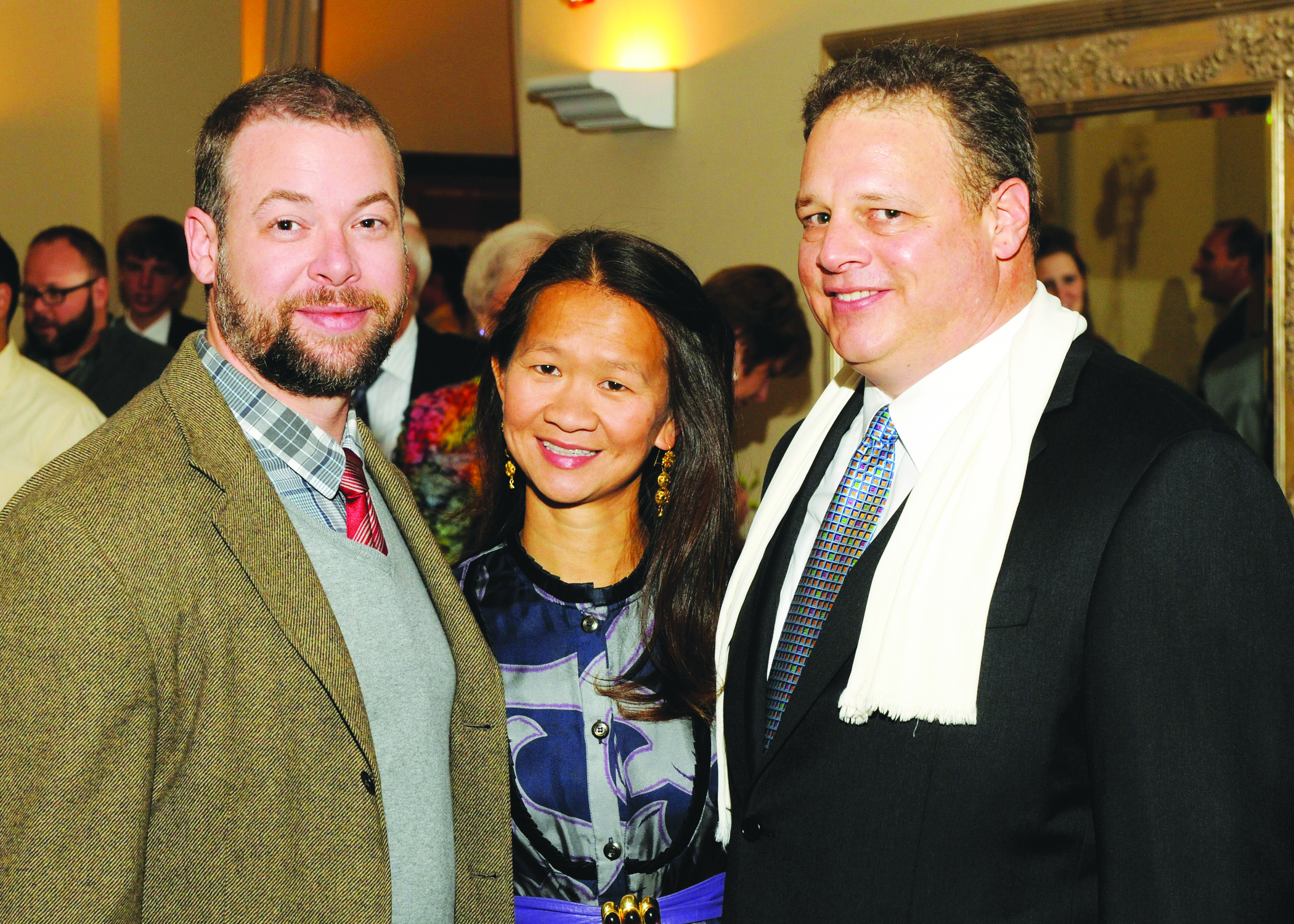 Trinh Huynh stands at mock trial fundraising event with the two other coaches, Brian Leah and Carol Gebo. Huynh was a coach of the team for 11 years.