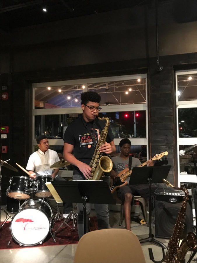 Jay Hammond solos at Evolution's gig at Mason Tavern. (photo by Sarah Likins)