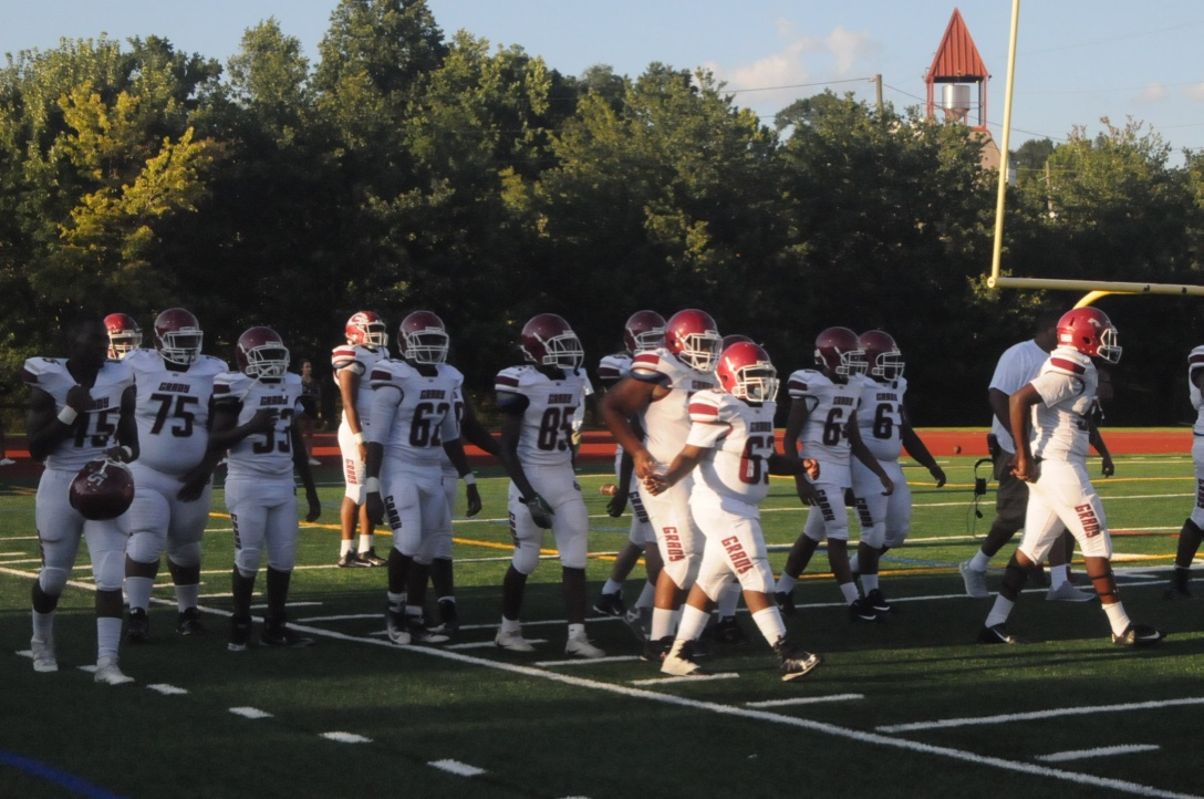 Knights varsity football team take the field before its season opener on Friday, Aug. 18. After scoring first, the Knights lost to rival North Atlanta 21-7 as the visiting team at Grady Stadium.