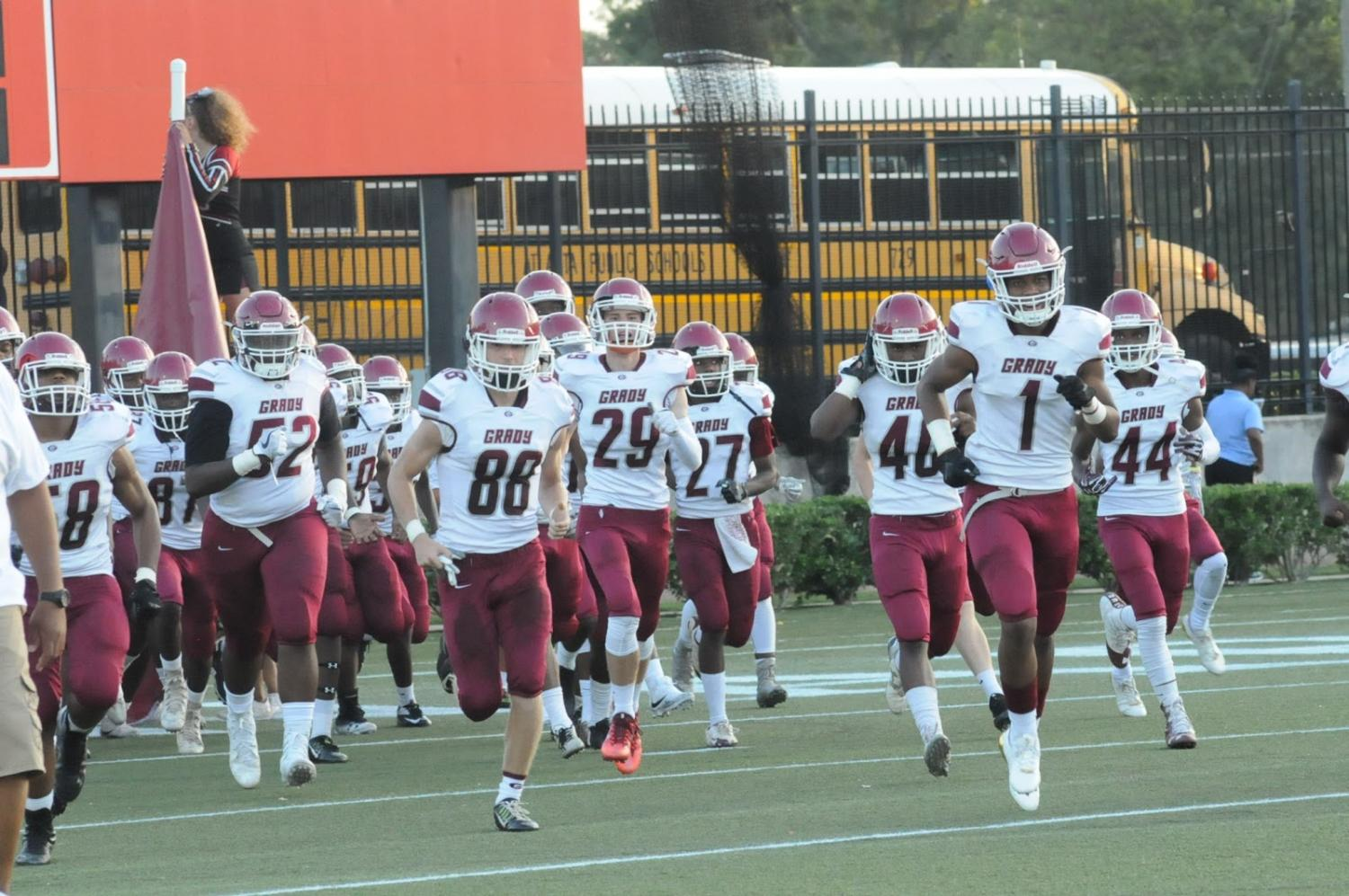 The Grady Knights take the field confidently before their 31-0 loss.