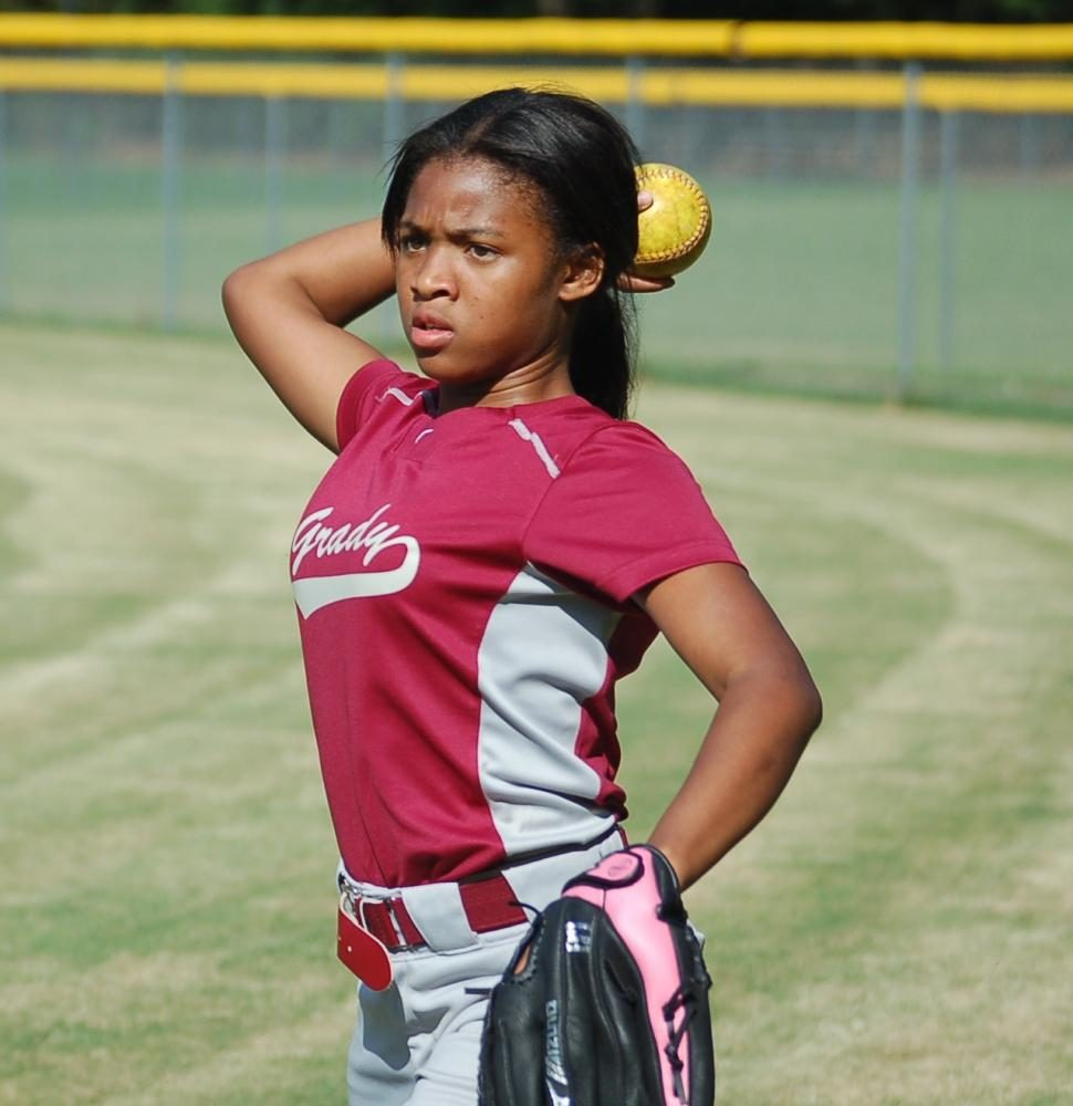 A Lady Knights player, Nariah Moore, warms up prior to a softball game on Aug. 17 against Therrell at Crim High School. Therrell won the game 24-2. Grady is looking to improve from a winless 2016 season.