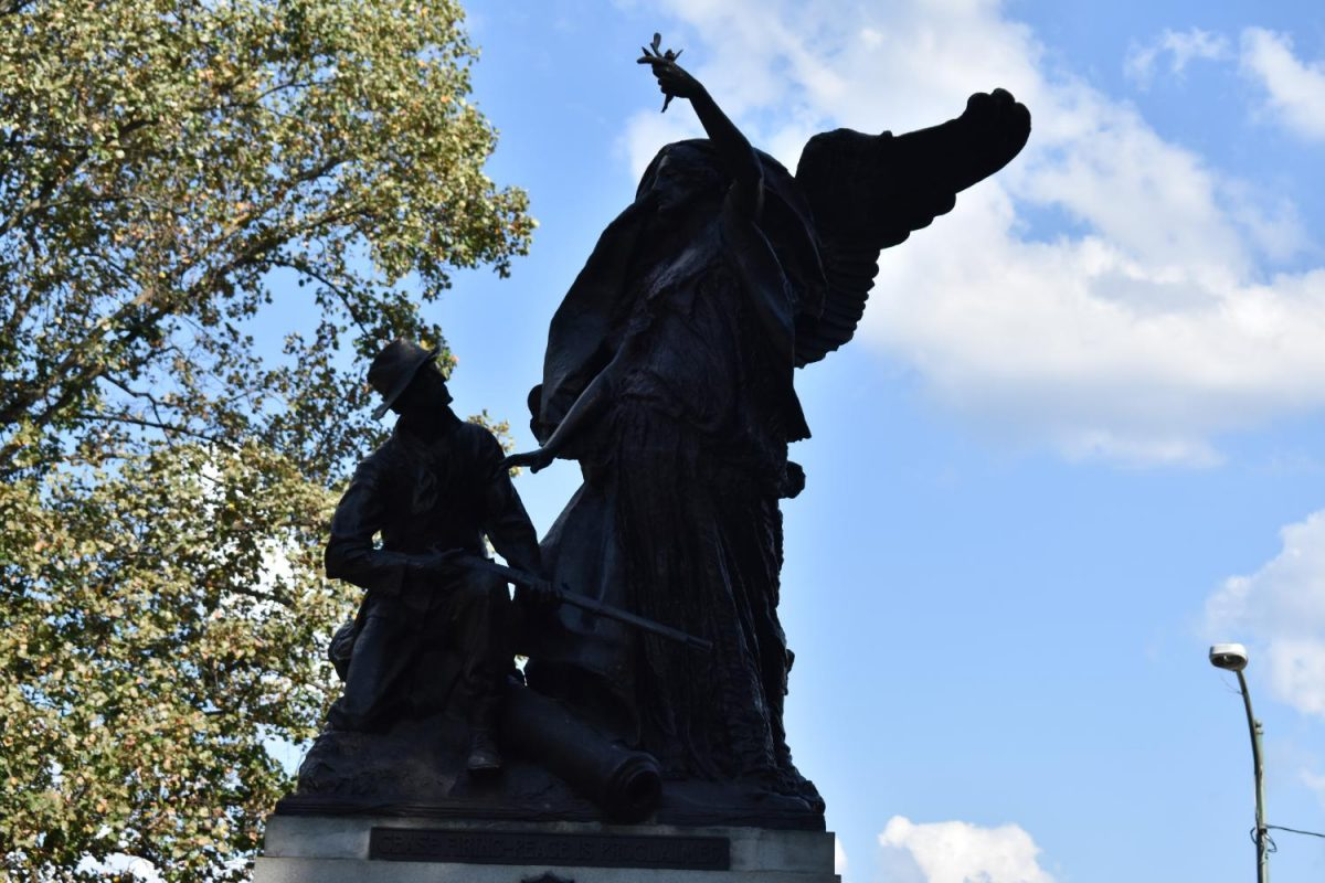 The+Peace+Monument%2C+which+features+an+angel+standing+above+a+Confederate+solider+guiding+him+to+lay+down+his+weapon.+The+monument+is+in+Piedmont+Park+was+defaced+by+protesters+following+