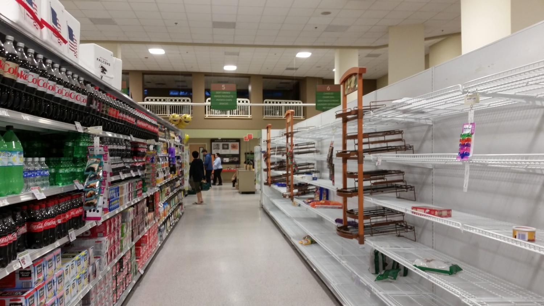 Atlanta citizen's raid grocery stores for nonperishables in preparation for the storm.