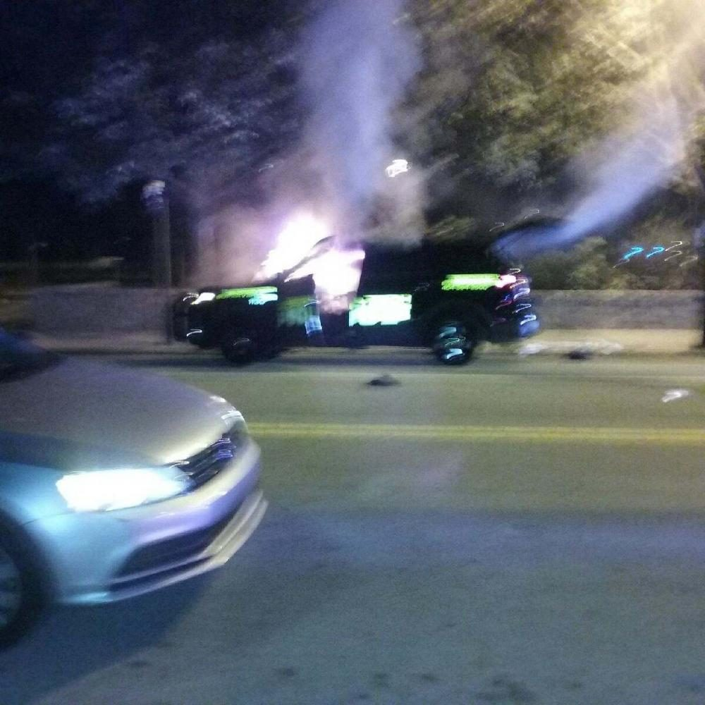 Tech+students+set+fire+to+a+police+car+after+the+vigil+for+Scott+Schultz.+