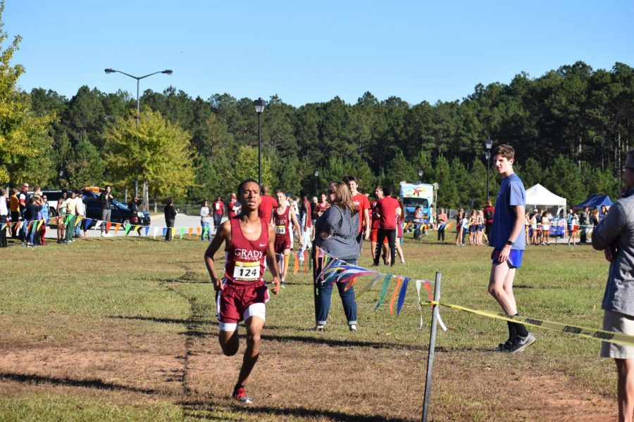 Senior+Aidan+Goldston+finishes+first+to+lead+the+Knights+boys+cross+country+team+to+the+Region+6AAAAA+title+on+Oct.+26.+Goldston+ran+a+career-best+16%3A40.+The+girls+team+also+won+the+region+title%2C+led+by+senior+Walden+Jones%2C+who+finished+third.