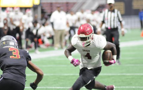 Knights tailback Craig Philpot looks for running room early in a game at Mercedes Benz Stadium on Oct. 21. Maynard Jackson won the contest 45-7.