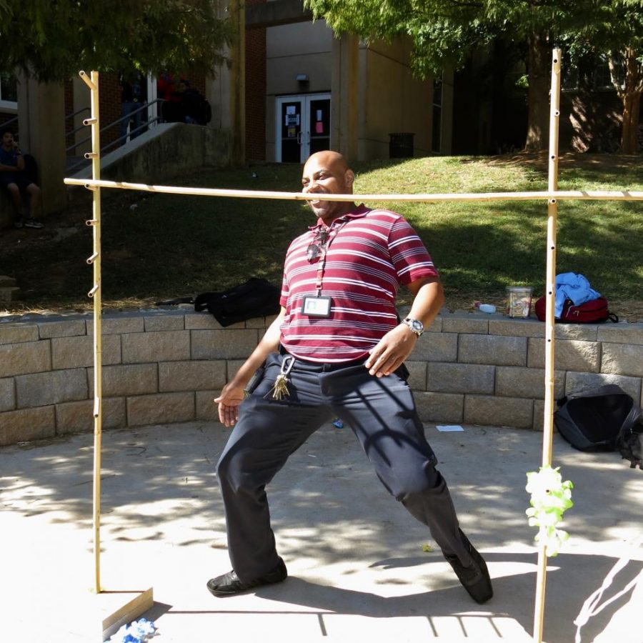 Assistant+Principal+Rodney+Howard+joined+in+the+luau+fun+and+tried+the+limbo+on+Tropical+Tuesday%2C+Oct.+3+during+Spirit+Week.