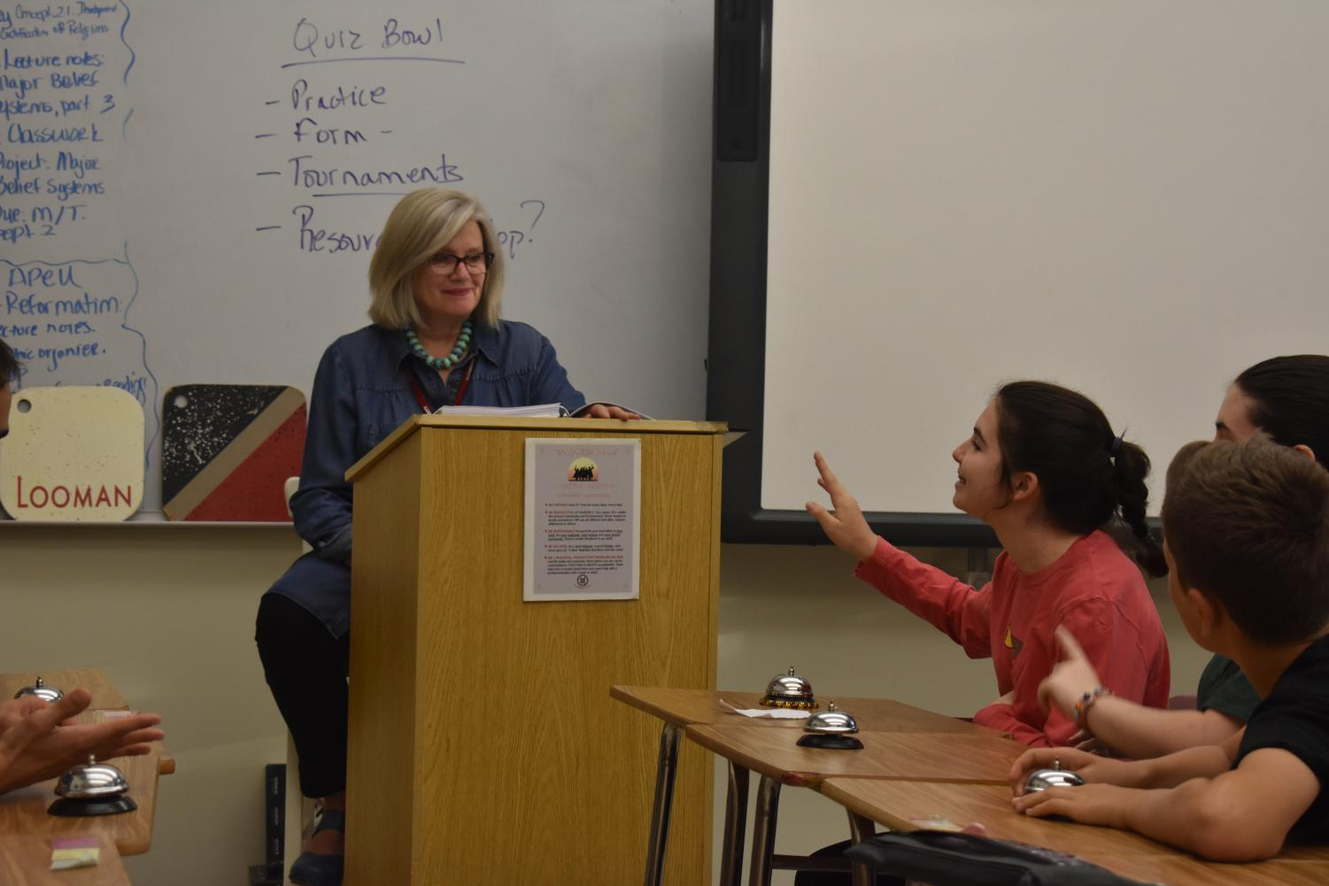FIRST TO THE BUZZER: Freshman Joanna Baker buzzes to answer practice questions posed by teacher sponsor Sarah Looman at Quiz Bowl's after-school practice.
