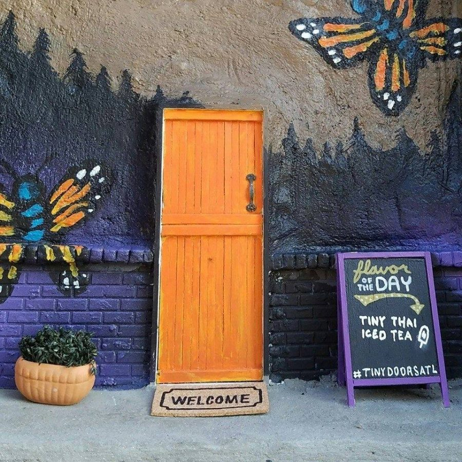 Scattered throughout the city, tiny doors can be found to mimic larger doors, like a King Of Pops stand in Inman Park.