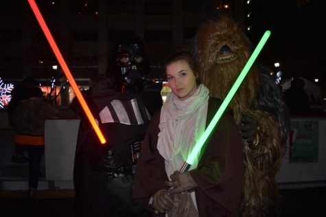 Skaters dressed as Chewbacca, Princess Lea, and Darth Vader, enjoy the holiday spirit.