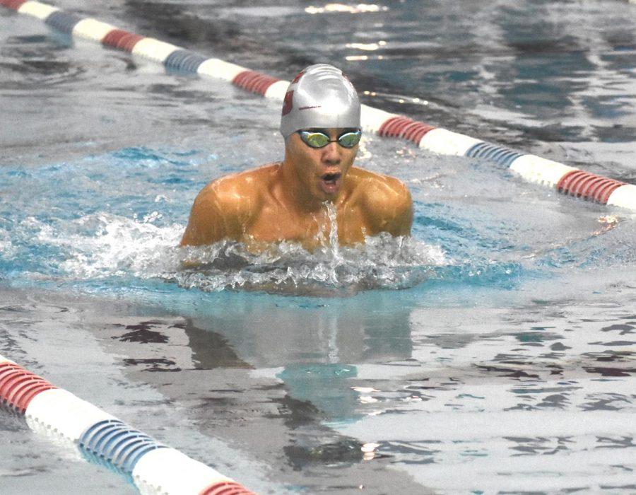 Sophomore Sebastian Gerz-Escandon comes up for a quick breath during a breaststroke race at a Tri meet at the Washington Park Natatorium pool on Nov. 14.