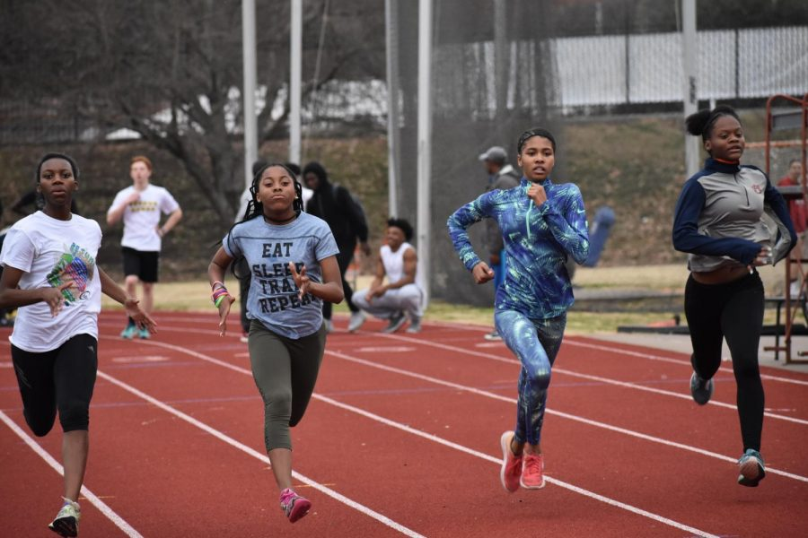 Freshman+sprinters+%28left+to+right%29+Kendall+Green%2C+MeKenze+Kelley%2C+Erin+Boone+and+Ameah+Richardson+open+their+high+school+track+careers+with+12x100+meter+sprints+with+a+minutes+rest+on+the+first+day+of+practice+on+Jan.+22%2C+2018.