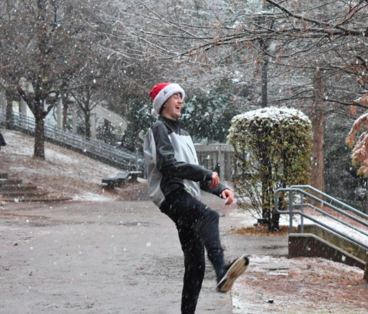 Sophomore Jack Palaian plays in the snow on Dec. 8th. Grady released early due to the weather conditions on this day.