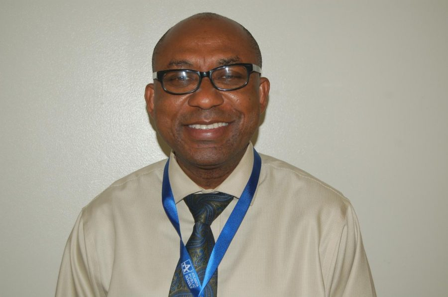 Mr.+Okeh%2C+originally+from+Nigeria%2C+now+teaches+in+the+science+department+at+Grady.+
