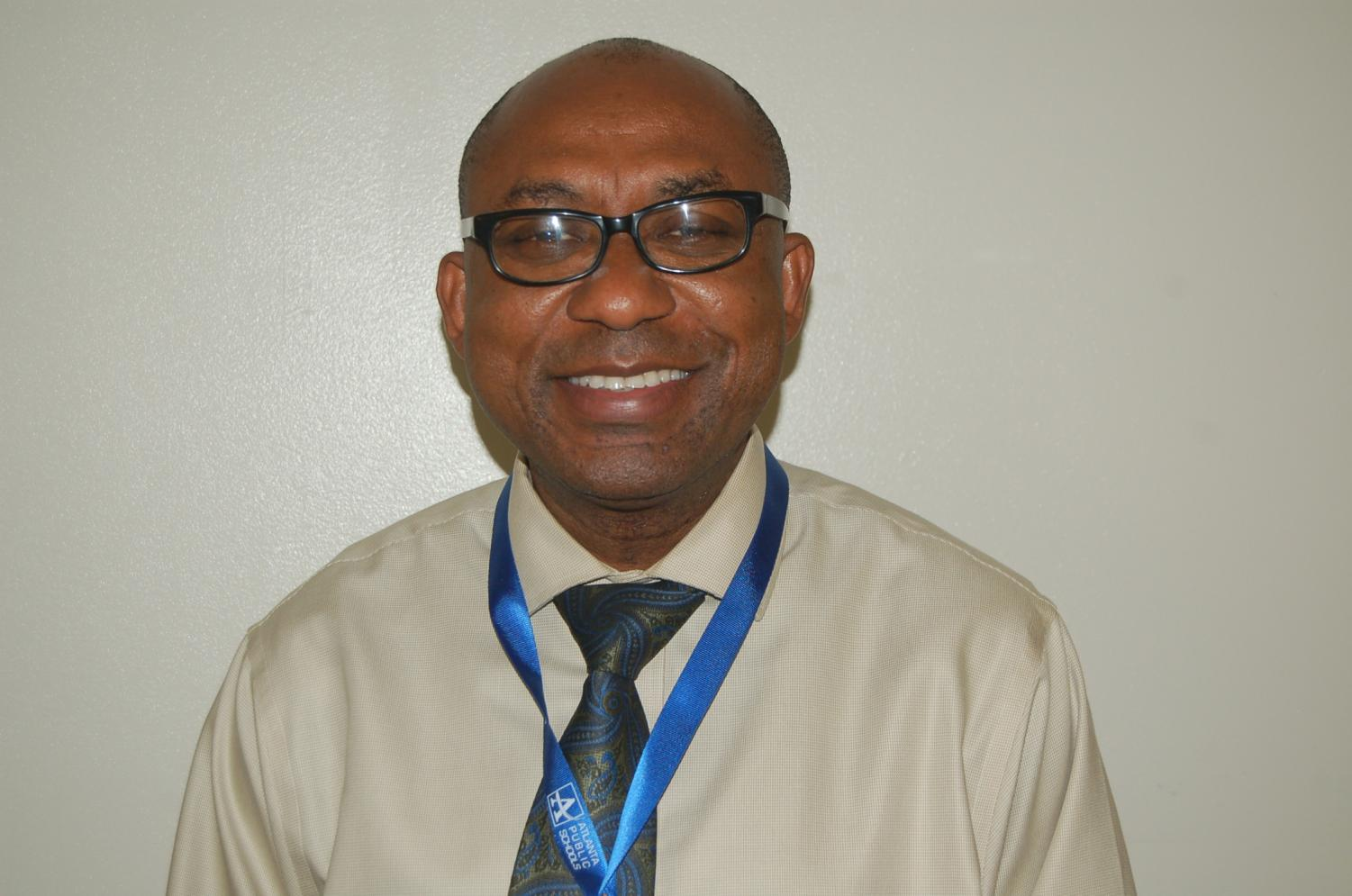 Mr. Okeh, originally from Nigeria, now teaches in the science department at Grady.