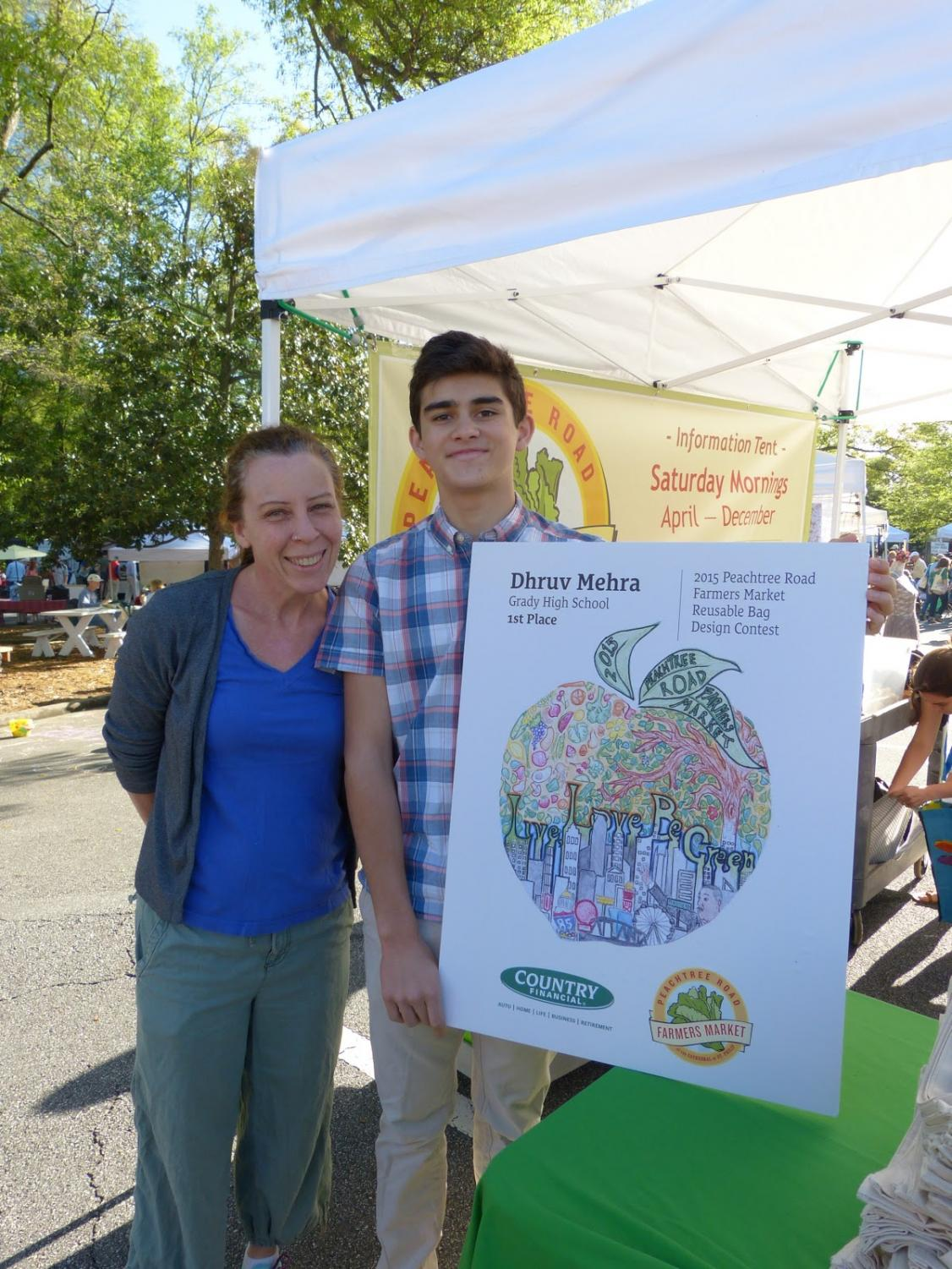 Dawn Wadsworth and Dhruv Mehra attend the first Peachtree Road Farmers Market of the 2014 season in early April. Mehra won first prize and a $1000 scholarship with his design that included images of the Atlanta skyline, the Capitol building, Dr. Martin Luther King Jr. and local produce.