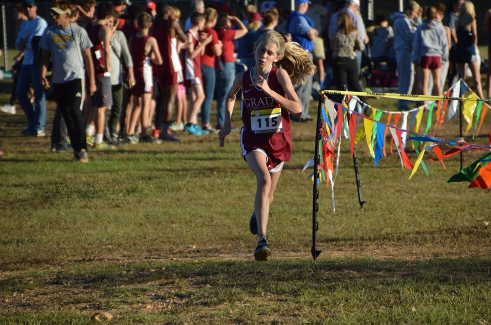 Race to the finish: Eighth grader Ellie Spears finishes second in the JV region cross country championships at Boundary Waters Park.