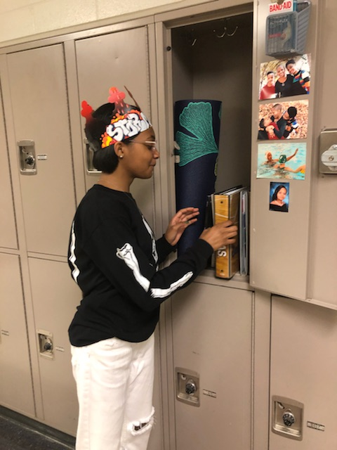 Junior+Storm+Wright+gets+books+our+of+her+locker.+She+is+one+of+the+few+upperclassmen+who+utilize+the+lockers.