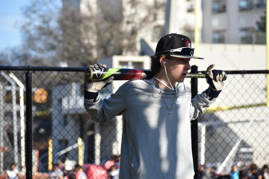 BATTER UP: Junior catcher Ben Lepik awaits a turn in the batting cage during an after-school practice. The Knights varsity baseball team finished 10-16 this season.