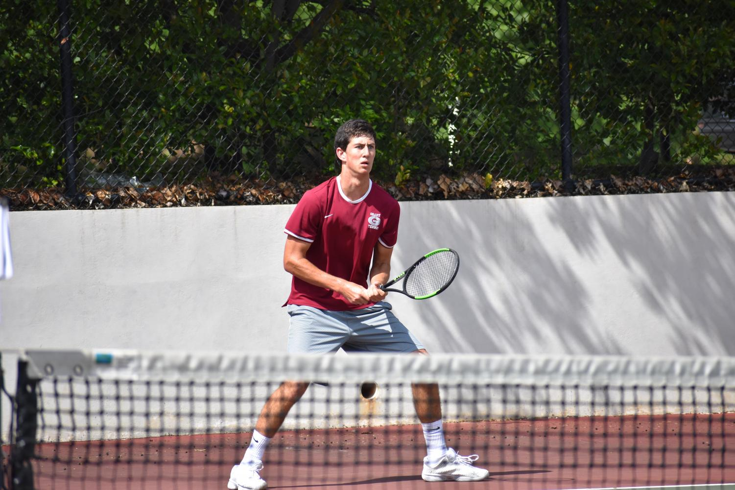 FIGHTING UNTIL THE END: Josh Wolfe stands ready to return serve against Flowery Branch. The Grady boys  failed to reach the Elite Eight this season.