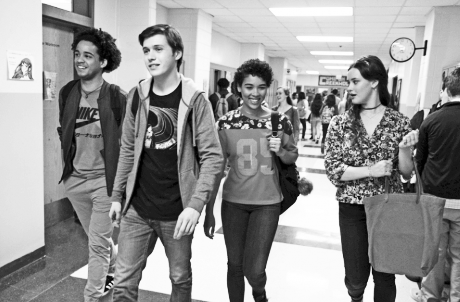 I'M COMING OUT: Shot at Gray, this scene shows Simon Spier (Nick Robinson) navigating the hallway with his friends, portrayed by (from left), Jorge Lendenborg Jr., Alexandra Shipp, and Katherine Langford