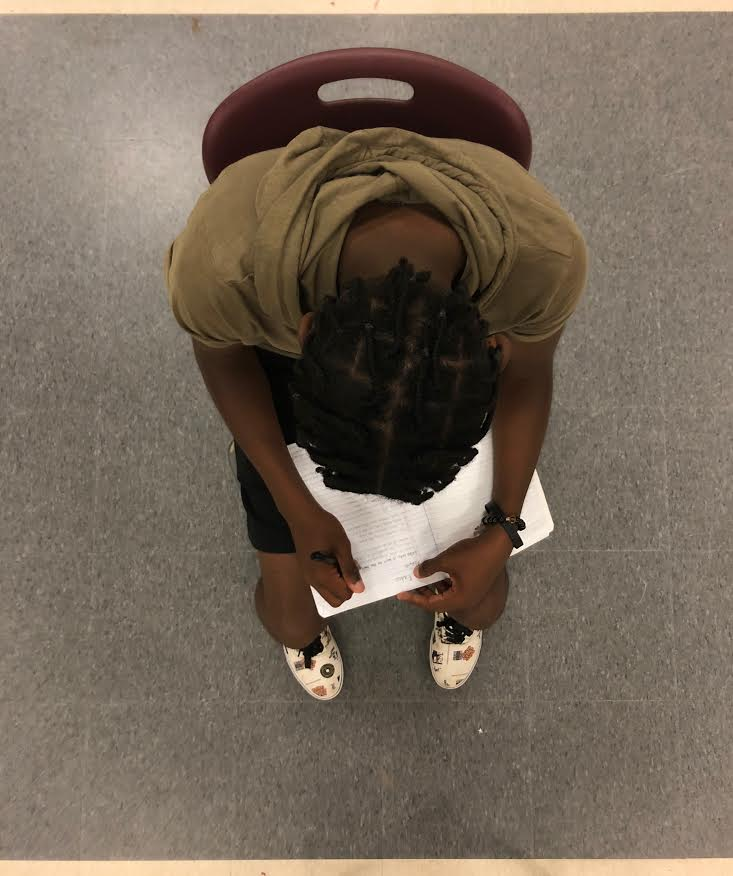 Sophomore Msemaji Anderson works on lyrics for his upcoming songs.