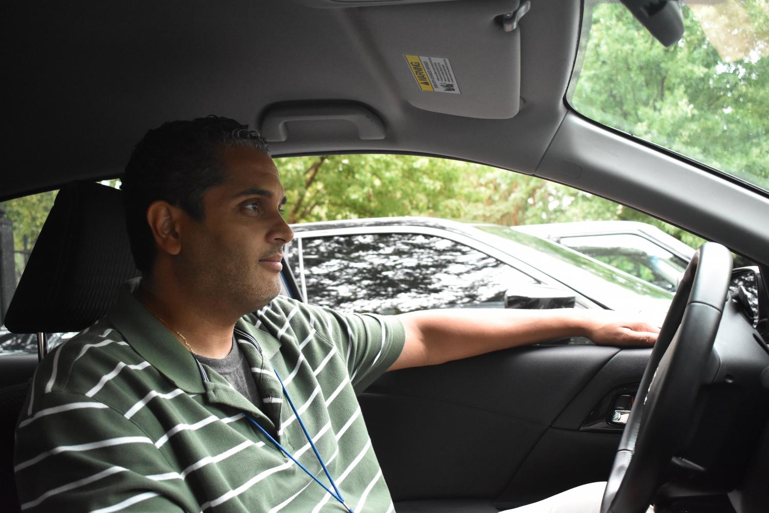 School Business Manager Byron Barnes studies the traffic patterns during his commute home from Grady High School.