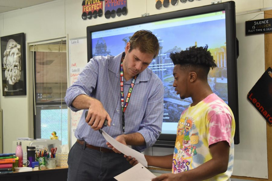 Grady teacher Mr. Hunter instructs first-year Latin student freshman Jalen Roberts in his Latin 1 class.