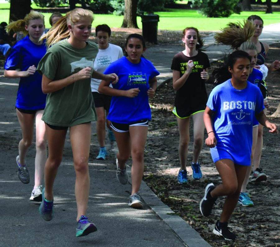 Speeding into the season: the girls cross country team runs through Piedmont Park during one of their training sessions.