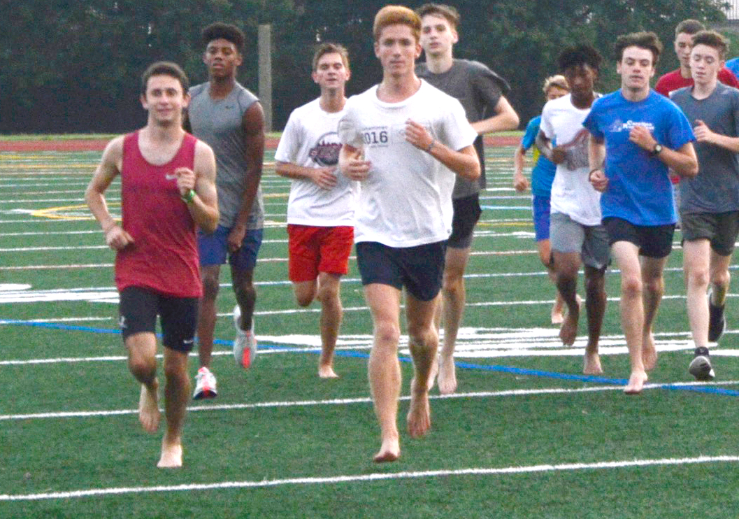 Taking it easy: The boys cross country team does a recovery run after a week of difficult workouts on the morning of Thurs. Aug. 23.