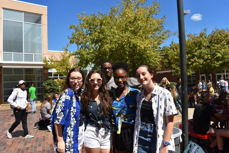 Students pose for pictures during second lunch on Stay Afloat Day. Most Grady students sported Hawaiian shirts and sunglasses.