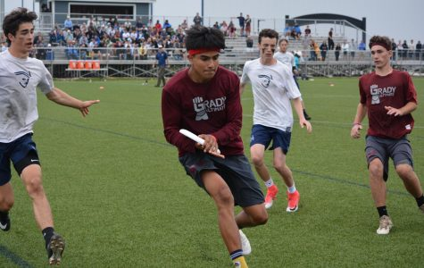Francisco Fernandez catches the disc in the teams game against Nathan Hale.   Photo creds: Meg Pearlstein