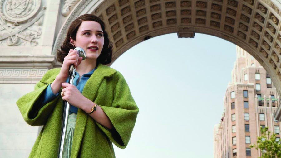 Maisel speaks in front of a crowd of protesters in Central Park